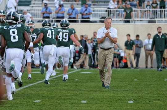 Aug 30, 2019; East Lansing, MI, USA; Michigan State Spartans head coach Mark Dantonio on the field during warm ups prior to the game against the Tulsa Golden Hurricane at Spartan Stadium. Mandatory Credit: Mike Carter-USA TODAY Sports