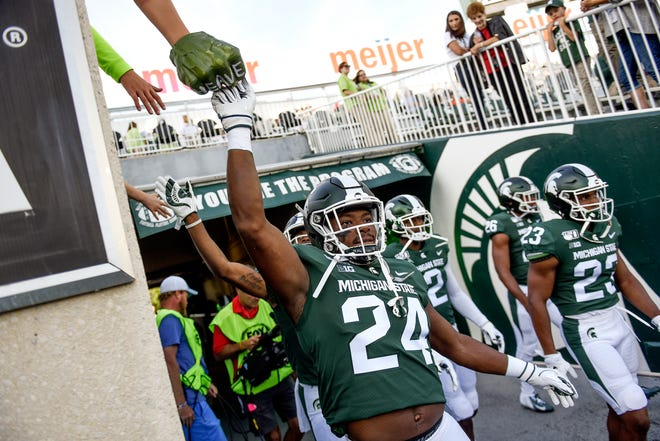 The Michigan State football team has dropped three nonconference games for 2020 as part of a Big Ten Conference move to take precautions against the spread of the coronavirus.