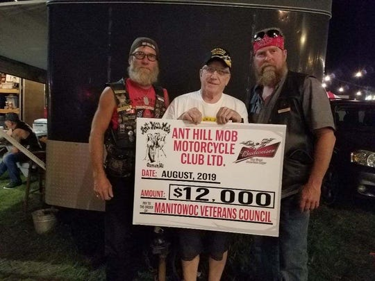 The Ant Hill Mob recently donated $12,000 to the Eternal Flame fund through the Manitowoc County United Veterans Council. Pictured from left are Vice President Perry Burnell, Chairman of the Manitowoc United Veterans Council Tom Hoffman and Ant Hill Mob President Scott Pankratz.