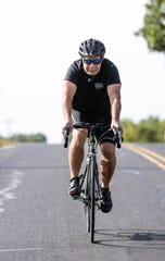 Dan Schmidt of Oshkosh prepares for his across state bike trip to raise money for student scholarships.