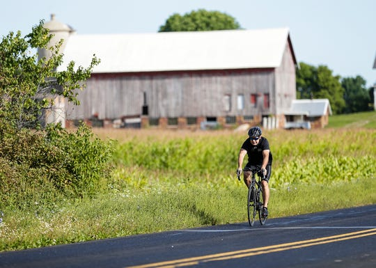 Dan Schmidt, a UW-Oshkosh kinesiology professor of 22 years, prepares to bike across the state in support of student scholarships.