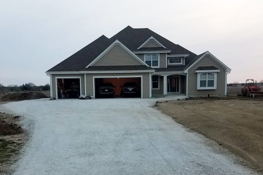 "On May 15, 2017, Shawn and Sarah Mayer of Mount Pleasant and their two young children moved into a custom-built, 3,800-square-foot home. One month later, they found out Foxconn was coming. ""When it was announced, I had just had 36 pallets of paving bricks delivered,"" Mayer says. The couple sold the new home and 8 acres to the village to make way for the project."