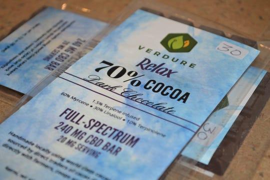 The Village CBD Shoppe has a whole side dedicated to edible products, like teas, Green Crown Swedish fish, gummy bears from CBD Hemp Edibles, and chocolate and honey from Cedarburg's Verdure.