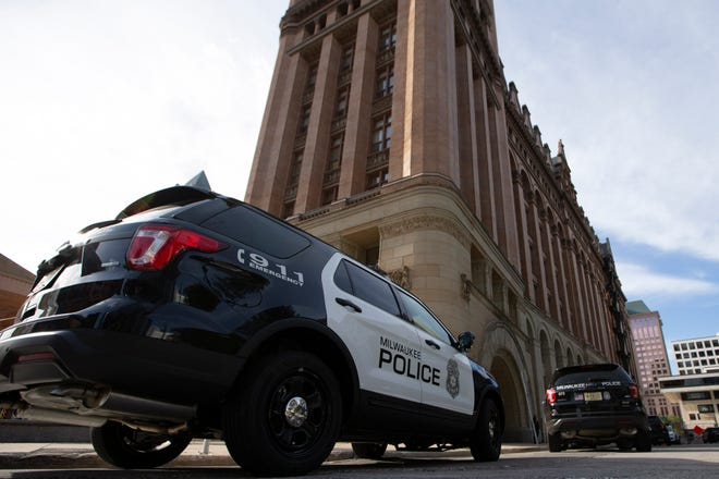 A Milwaukee Police Department squad car sits outside City Hall in August 2019.