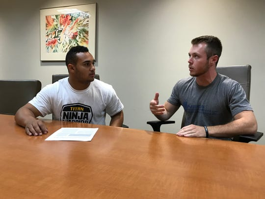 UW-Oshkosh kinesiology students Bryce  Herlache (left) and Kyle Gums chat on campus. Gums is the president of the Kinesiology Club and Herlache is the vice president.