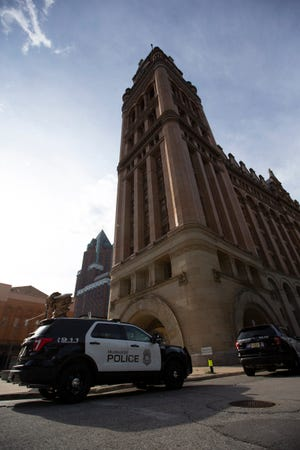 Police respond to a report of a bomb threat at City Hall on Friday afternoon.