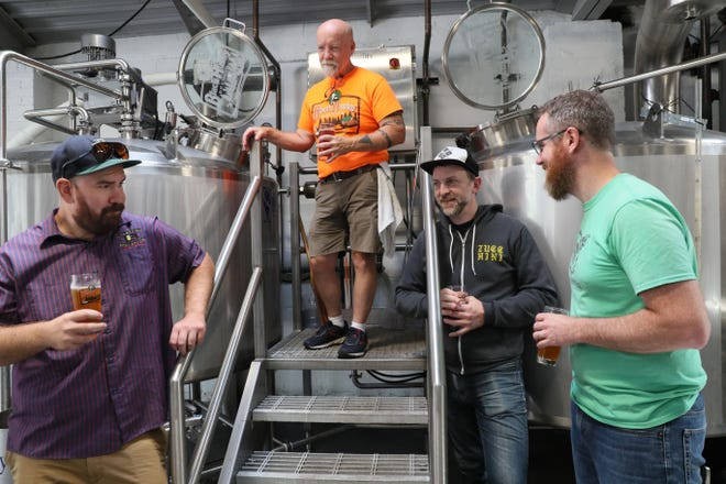 Four Milwaukee breweries, organized as the Riverwest Brewery Syndicate, made their first collaboration beer, a Sticke Altbier. Brewers on the project include, from left, Tyler Senz of Lakefront Brewery, Tim Eichinger, co-owner and brewer for Black Husky brewing, George Bregar, founder of Company Brewing and Joe Yeado, founder of Gathering Place Brewing.