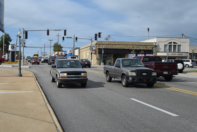 Friday afternoon traffic rolls past the Veterans Plaza in downtown Mountain Home. The Arkansas Department of Transportation has recently been counting the amount of traffic through town, something it does once a year.
