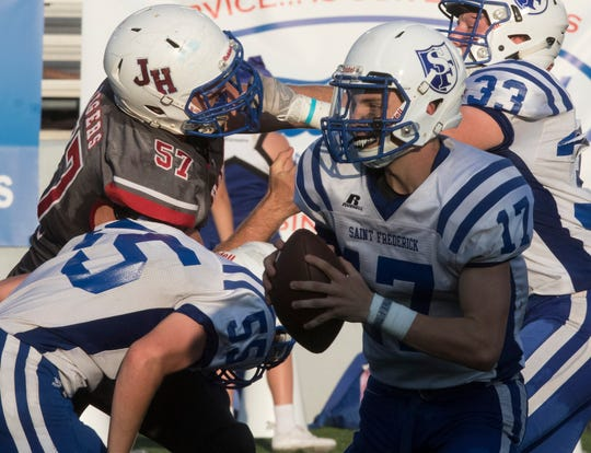 St. Frederick quarterback Alex Rightsell (17) completed all six of his passes at D'Arbonne Woods last Thursday, throwing for 121 yards and four touchdowns in a 54-0 win.