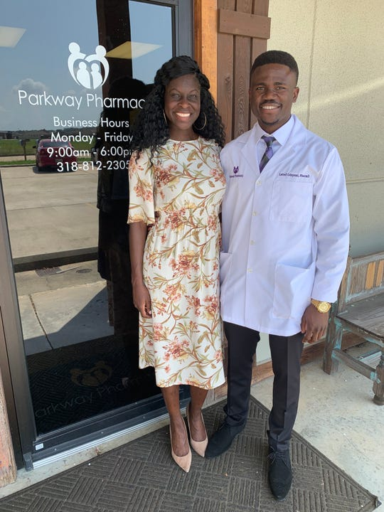 Parkway Pharmacy in Sterlington celebrated its opening with a ribbon cutting on Aug. 22. Pictured are Adebola Shoyebi and Lateef Odeyemi, pharmacist.