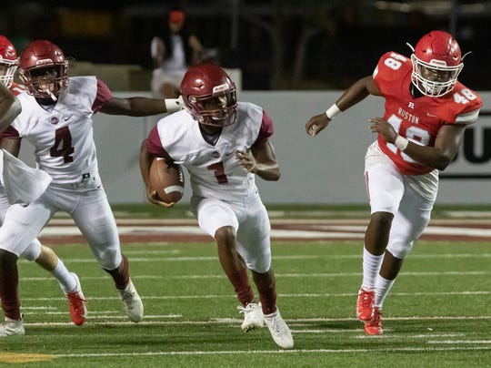 Behind an offensive line with three new starters, senior running back Chaunzavia Lewis (1) ran for Ouachita's lone touchdown in a 20-6 loss to Ruston at Bayou Jamb.