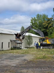 A building on the property of the former Quirk Moving and Storage Company is razed to clear it for a new 126-unit residential development off Furnace Pond on Netcong. August 28, 2019.