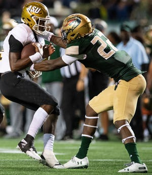 UAB edge rusher Jordan Smith (22) makes a sack against Alabama State in 2019. The Jaguars drafted Smith in the fourth round Saturday.