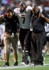 Alabama State quarterback Darryl Pearson, Jr., (7) is helped from the field after being injured against University of Alabama Birmingham at Legion Field in Birmingham, Ala., on Thursday August 29, 2019.
