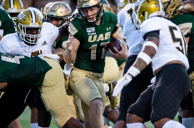 UAB quarterback Tyler Johnston, III, (17) carries for a touchdown against Alabama State at Legion Field in Birmingham, Ala., on Thursday August 29, 2019.