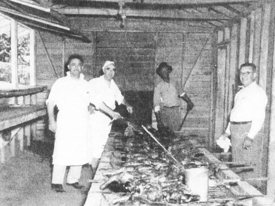 Bill Miaoulis, from left, Peter Xides, an unknown helper, and Gus Berdanis grill chickens for hungry barbecue-goers in the late 1940s.