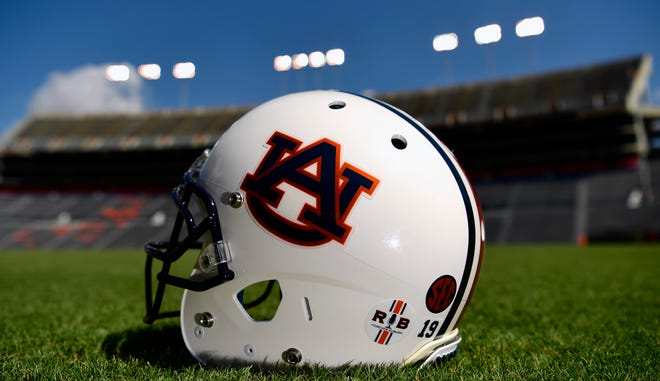 An Auburn football helmet on the field at Jordan-Hare Stadium