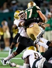 Alabama State defensive back Irshaad Davis (22) wraps up UAB quarterback Tyler Johnston, III, (17) at Legion Field in Birmingham, Ala., on Thursday August 29, 2019.
