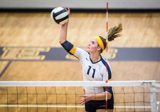 FILE -- Delta's Molly Hunt hits against Daleville during their game at Delta High School on Aug. 29, 2019. Hunt scored her 1,000th kill during the game.