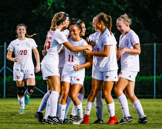 Stewarts Creek players celebrate a goal by Kinley Buena (11) during a 4-1 win over Oakland.