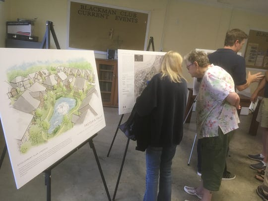 Neighbors examine plans for the proposed Pretoria Falls subdivision on Asbury Lane and Asbury Road and along Overall Creek. The Murfreesboro Planning Commission will hold a public hearing on the annexation and zoning for the project Wednesday.