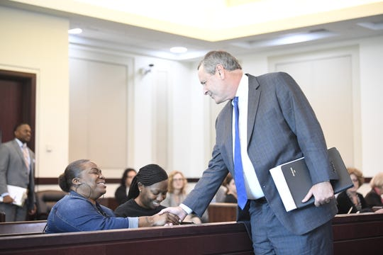 District Attorney Glenn Funk greets sisters Katrina, left, and Shawanna Norman on Friday, Aug. 30, 2019. Funk proposed a deal allowing Abu-Ali Abdur'Rahman to spend the rest of his life in prison instead of being put to death on April 16. Abdur'Rahman was convicted in a 1986 stabbing case that killed the sisters' stepfather, Patrick Daniels, and wounded their mother, Norma Jean Norman.