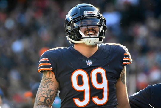 Chicago Bears outside linebacker Aaron Lynch (99) of Island Coast reacts after an injury against the Green Bay Packers during the second half at Soldier Field.