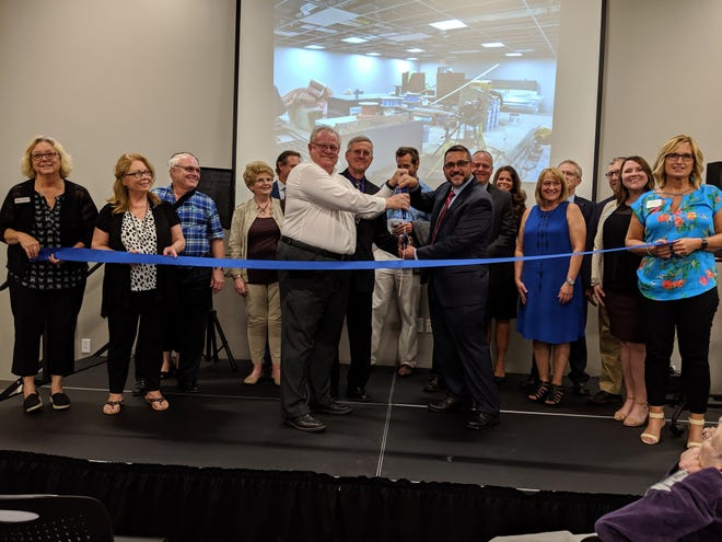 Licking County Board of Developmental Disabilities Superintendent Jason Umstot was joined by Mayor Jeff Hall and members of the LCBDD Board of Directors in cutting the ribbon for the rededicated E.S. Weiant Center in June.