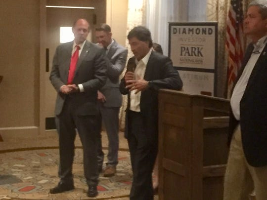 "Congressman Troy Balderson speaks at ""Washington Night"" Aug. 29 at the Granville Inn, as State Senator Jay Hottinger (left) and State Representative Scott Ryan (right) listen."