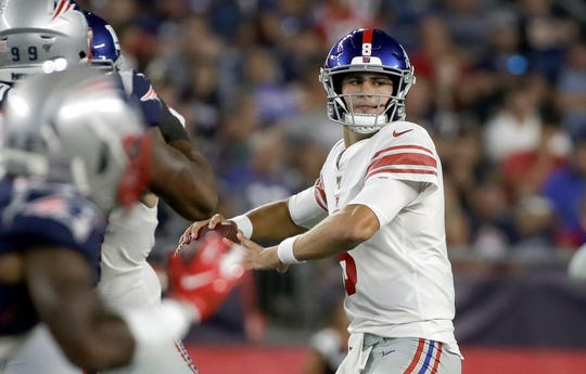 New York Giants quarterback Daniel Jones drops back to pass against the New England Patriots in the first half of an NFL preseason football game, Thursday, Aug. 29, 2019, in Foxborough, Mass. (AP Photo/Elise Amendola)