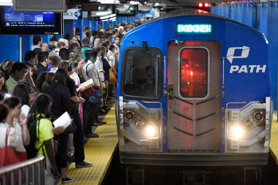 Commuters wait to board an incoming Hoboken PATH train at the 33rd St. PATH Station during day one of Penn Station repairs on Monday, July 10, 2017.