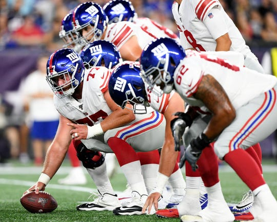 Aug 29, 2019; Foxborough, MA, USA; New York Giants center Spencer Pulley (77) prepares to snap the ball against the New England Patriots during the first half at Gillette Stadium. Mandatory Credit: Brian Fluharty-USA TODAY Sports