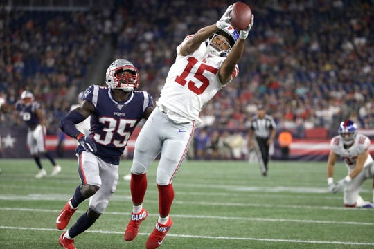 New York Giants wide receiver Golden Tate (15) catches a pass in front of New England Patriots defensive back Keion Crossen (35) in the first half of an NFL preseason football game, Thursday, Aug. 29, 2019, in Foxborough, Mass. (AP Photo/Elise Amendola)