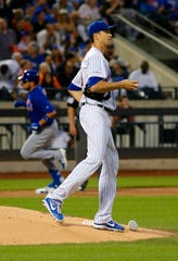 Chicago Cubs first baseman Victor Caratini (7) runs the bases after hitting a solo home run as New York Mets starting pitcher Jacob deGrom (48) reacts during the second inning at Citi Field.