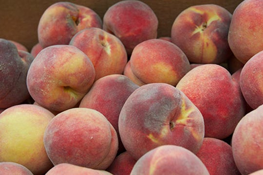 Locally-grown peaches delivered by the Southwest New Mexico Food Hub are destined for the cafeteria trays of students in Lordsburg. The newly awarded USDA Farm to School grant will expand sales of locally grown produce to the 8,200 public school students in seven public school districts in southwest New Mexico.