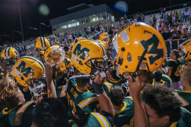 The Mayfield Trojans celebrate after their win at over the Del Valle Conquistadors from El Paso at the Field of Dreams in Las Cruces on Thursday, Aug. 29, 2019.