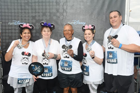 Retired Las Cruces Police Officer Narciso Valdez at Walt Disney World in Florida  with his family after running a half marathon.