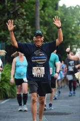 Narciso Valdez crosses the finish line after completing a half marathon in Florida in April, despite fighting cancer.