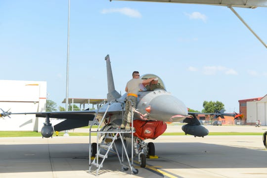 Staff Sgt. Cody Brown, 138th Maintenance Squadron, polishes the canopy of an F-16 fighter jet as part of the post-flight procedures on July 13, 2016 at the 138th Fighter Wing.  The wraparound canopy provides ideal light in-flight and can withstand the impact of a 4 pound bird at 550 knots.