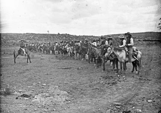 A group of mounted Navajo scouts sits in formation, circa 1880s. Ben Wittick, courtesy of Palace of the Governors Photo Archive, New mexico History Museum (NMHM/ DCS)