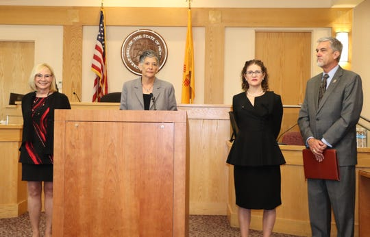 Chief Justice Judith K. Nakamura, center, announces the start of a new service that allows New Mexicans to negotiate online to settle debt and money due lawsuits. Joining the Chief Justice at a news conference on June 3 were Terri Cole, left, president and chief executive officer of the Greater Albuquerque Chamber of Commerce; Second Judicial District Court Judge Jane C. Levy, right), and Jerry Dixon, far right, president of the State Bar of New Mexico