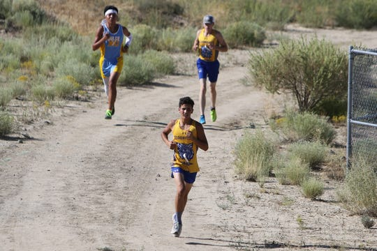 Bloomfield's Samuel Eveland pulls ahead of Dulce's Rossendo Julian and BHS teammate Jacob Benedict on one of the uphill trails during Thursday's Aztec Invitational at the Aztec Tiger Sports Complex. Eveland won the boys race in 22 minutes, 3.03 seconds.