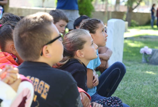Students from McKinley Elementary School listen to a presentation during a dress rehearsal on Aug. 30 for Rio del Sol Kiwanis Club's Dining with the Dead at Greenlawn Cemetery in Farmington.
