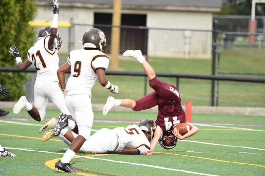 Seaholm senior running back Chaz Strecker gets up ended.