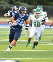 Livonia Stevenson running back Caden Woodall gets up and running during the Spartans' game against Novi on Aug. 29, 2019.