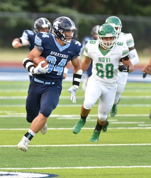 Livonia Stevenson running back Caden Woodall gets up and running during the Spartans' Aug. 29 game against Novi High.
