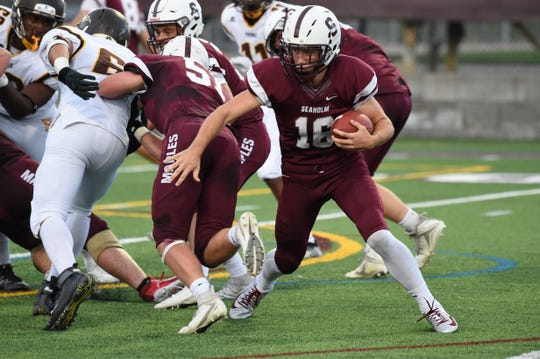 Seaholm junior quarterback Caleb Knoer fights for yards on a run