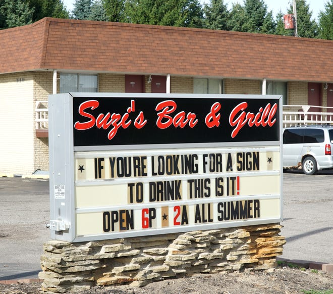 Suzi's Bar and Grill at 26800 Pontiac Trail has an eye-catching sign for its patrons in this 2019 file photo.