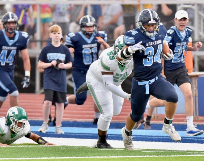 Stevenson's Caden Woodall runs to the end zone for his second touchdown of the game against Novi on Aug. 29, 2019.