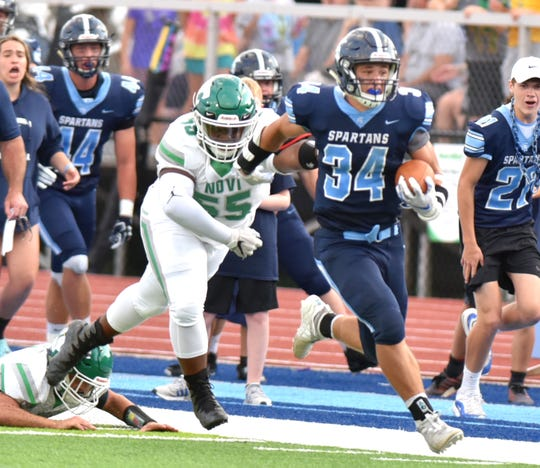 Livonia Stevenson running back Caden Woodall rushes for the Spartan's second touchdown on Aug. 29.